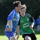 John McManus of Wexford Celtic and Cian Boggan of Crossabeg battle for possession