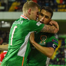 James McClean celebrates with captain Seamus Coleman after scoring Ireland's second goal