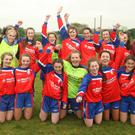 Under 18 schoolgirls cup final at, St. Joseph's AFC grounds; winning team, Curracloe with their capt., Sadbh Mc Carthy and 'Player of the Match', Fiona Kinsella
