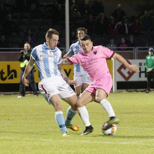 Jack Tuite of Shelbourne closes in on Ricky Fox of Wexford FC