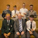 The Horse & Hound Youth player of the year award winners. Seated are Denis Hennessy, Chairman of Wexford League; Peter Doyle, Leinster Football Association; Youth Division 4, Kevin Kenny, Tombrack United. Standing: Youth Division 3, Jamie Wallace, Campile United; Youth Premier Division, Jamie Thomas, Wexford Albion; Youth Division 2, Seán Keane-Carroll, Curracloe United, and Youth Division 1, Stephen Kavanagh, Bunclody AFC