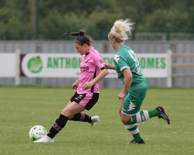 Aisling Frawley delivers a pass as she's closed down by Natalie O'Brien of Cork City