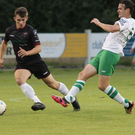 Aaron Dobbs takes the ball away from Cabinteely's experienced captain, Daire Doyle