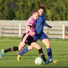 Claire O'Riordan of Wexford Youths is tracked by Manulla F.C. defender Michelle Ruane