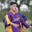 Wexford Albion's Liam O'Connor keeps his eyes on the ball
