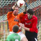 The Ballymurphy Celtic goalkeeper gathers possession during their FAI Junior Cup match against New Ross Celtic