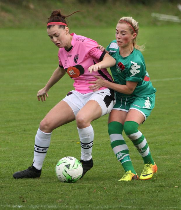 Lauren Dwyer of Wexford Youths shields the ball from Cork City's Danielle Sheehy