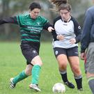 Noelle Jordan of St. Cormac's and Becky Foley of Shelburne battle for possession during their Women's Divisional Shield Group D game on Sunday
