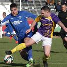 Shane Dempsey of Wexford shields the ball from the A.U.L. defender John Lester.