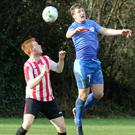 Aaron Collier of Bunclody and Kyle Dempsey of North End United battle for the ball in the air.