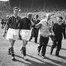 A piece of history: After helping Manchester City win the FA Cup against Birmingham City, goalkeeper Bert Trautmann leaves the field rubbing his 'sore'' neck. It later transpired he had broken it. Allsport Hulton/Archive