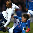 Ryan Delaney slides in to challengeTottenham Hotspur's new signing, Lucas Moura, in Sunday's drawn FA Cup fifth round tie in Scotland