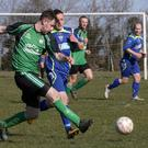 Mark Crosbie of Crossabeg is tracked by Gary Sinnott of New Ross Town