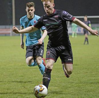 Chris Kenny of Wexford F.C. is watched by Cobh's Charlie Fleming