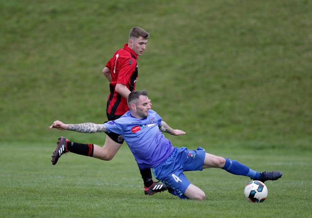 Declan Downes of North End United slides in to win the ball during North End's recent FAI Cup win over Cherry Orchard