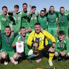 Kiltealy Celtic celebrate after winning the Gwyn Jones Cup final, to add to their Division 5 success