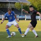 Aaron Dobbs battling with Finn Harps defender Keith Cowan on his return to competitive action