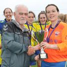 Jenny Delaney receiving the trophy from league Chairman Daire Doyle