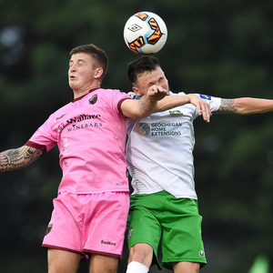 Ryan Nolan of Wexford FC battles it out in the air with Cabinteely's Jack Watson