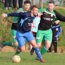 P.J. Banville of Campile United is tracked by Páidí Cullen and Martin Kehoe of Cloughbawn during their Division 1 match in Clonroche