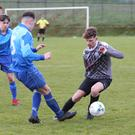 Ciaran Carthy of North End United closes in on New Ross Celtic's Daniel Kuda