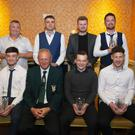 Standing, from left: Davy Byrne, representing Division 5 Player of the Year Beau Brennan of Wexford Bohs; Division 3A Player of the Year Conor Clancy of Rosslare Strand; Premier Division Player of the Year James Pearce of Moyne Rangers, and Division 2 Player of the Year Colm Purcell of Adamstown. Seated are Division 3 Player of the Year David Christie of Gorey Rangers; Denis Hennessy, Chairman, Wexford Football League; Division 4A Player of the Year Seán McCann of Cloughbawn, and Division 1 Player of the Year Páidí Cullen of Cloughbawn