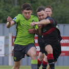 Left winger Emmet Nugent battling for possession with Drogheda United captain Jake Hyland
