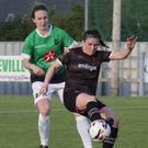 Aisling Frawley of Wexford Youths Women has Peamount United's Karen Duggan breathing down her neck