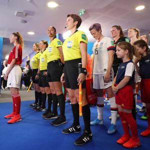 Assistant referee Michelle O'Neill in the tunnel in front of USA captain Megan Rapinoe before Sunday's Women's World Cup final in Lyon, France