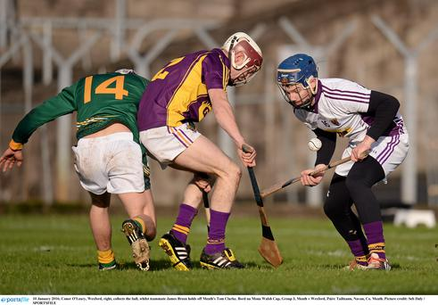 10 January 2016; Conor O'Leary, Wexford, right, collects the ball, whilst teammate James Breen holds off Meath's Tom Clarke. Bord na Mona Walsh Cup, Group 3, Meath v Wexford, Páirc Tailteann, Navan, Co. Meath. Picture credit: Seb Daly / SPORTSFILE