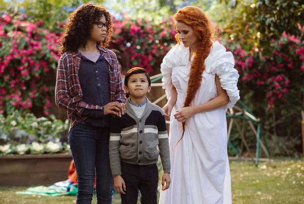 Storm Reid as Meg Murry, Deric McCabe as Charles Wallace Murry and Reese Witherspoon as Mrs Whatsit in A Wrinkle In Time.