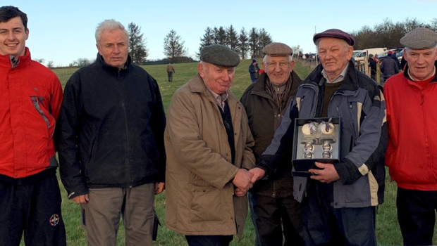 During their recent Annual Coursing meeting Frank Meehan, chairman, Kilcreevin & Ballymote Coursing Club, makes a presentation to Tom Bagnell who has served as the Club's Honorary Secretary for 50 consecutive years, also in photo are Slippers ThomasMagee and Richie Quinn, John O'Donnell and Luke Kilcoyne