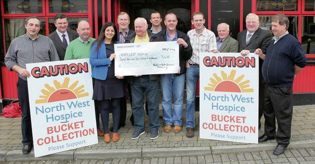 Pictured at Foley's Bar presenting the cheque from Joe Leonard's 'Nuts and Bolts and Hip Hop Party' were from left: Trevor Matthews, Clr Michael Clarke, Declan Gallagher, Bernadette McGarvey, Community Relations Manager North West Hospice, Clr Jerry Lundy, Joe Leonard, Paul Taylor, Denis Quinn, Michael Foley, Clr Michael Fleming, Eamon Scanlon and Frank Murphy.