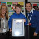 Miriam Ryan, Foróige Area Manager and Paul Scully, Buying Director, Aldi Ireland present Luke Kerrigan, Sligo (14) with a Certificate of Achievement at the Foróige Youth Citizenship Awards in partnership with Aldi Ireland, which took place in the RDS Dublin recently. Luke was also honoured as a Best Display Award winner at the awards