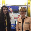 "Mairead McGuinness MEP is pictured at the BT Young Scientist and Technology Exhibition meeting Student Aoife Kearins, from Ursuline College Sligo. Aoife's project was entitled ""Eye Opener: Helping Drowsy Drivers Say Safe"""