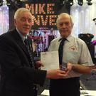 Patsy Fowley, of Cliffoney, being presented with his long service medal and letter from RNLI CEO Paul Bossier by Lifeboat Operations Manager for Bundoran RNLI,Tony McGowan, following 43 years of service with the organisation