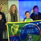 A Sligo County Council banner was presented to Scoil Naomh Molaise recently. Taking part in the presentation were from left to right: Adam O'Brien. Mr Seamus Connolly, Councillor Marie Casserly, Tristan Watters, Ms Philomena O'Connor and Edward Donagh.