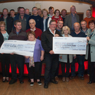 On the 25thAnniversary of the Hospice/Culfadda Fun Walk, a couple of nice numbers, on the right Nuala Ginnelly - second from the right - Hospice Manager and Kiernan McGill with a cheque for 10,340 Euros, the grand total for this year and on the left, 316,521 Euro the total raised in the 25 years of Culfadda/Hospice Fun Walks seen here surrounded by some of the participants, helpers and friends. Very well done everyone