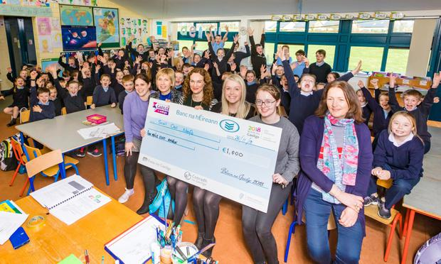 Pupils and staff of Bunninadden N.S are presented with €1000 prize from Sophie Osborne of Conradhna Gaeilge. The school was awarded the top prize for Co. Sligo in the Irish Song Competition with their song and video 'Amhran Scoil Chroí Naofa'. It comprised singing, rapping as Gaeilge as well as Irish dancing and traditional music