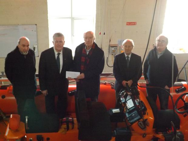 Norman Reid on behalf of the Freemasons of North Connaught presenting a cheque for €800 to David Godsell of Sligo RNLI. (L to R) Paddy Gilmartin, Norman Reid, David Godsell, David McNeill, William Murphy