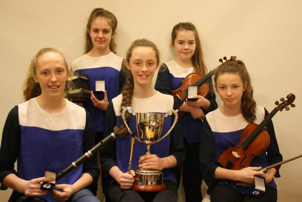 The group of Easkey musicians, winners of the Ceol Urlise section at the recent Sligo Scór Finals. Back row: Lauren Scott, Amy Harte. Front row: Ellen McGuire, Aisling McGuire, Elisha Scott. They now represent Sligo at the Connacht Finals on January 13th