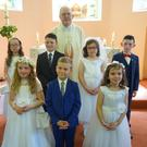 Children from Ballinlig and High Park Schools on the occasion of their First Holy Communion with Fr Michael O'Horo in Dromard Church