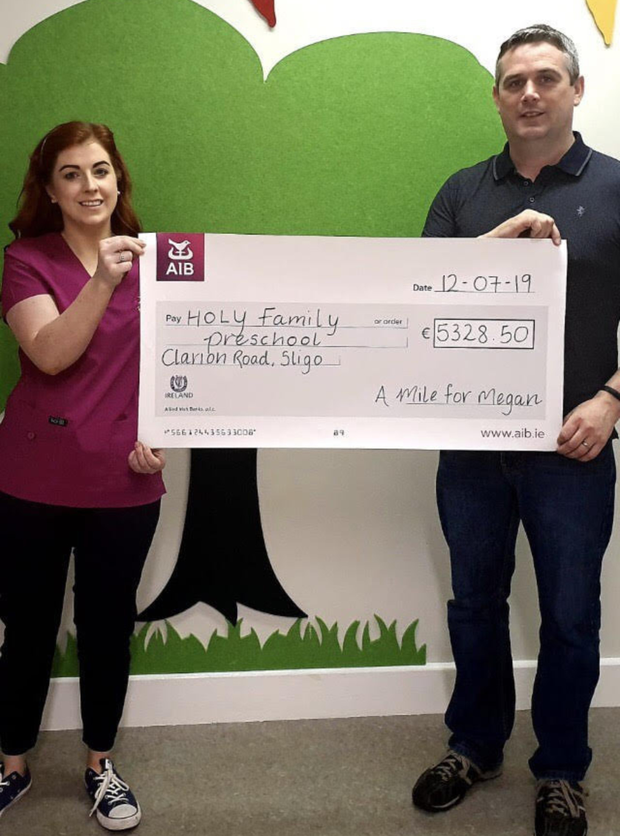 Proceeds from 'A Mile for Megan' sponsored swim has been divided between the Holy Family Specialised Preschool & The Jack & Jill Foundation. Our sincere thanks to all those who organised, sponsored & participated in any way towards the event. Pictured: John McGoldrick (parent) presenting a cheque to Eimear Merrick (staff nurse) Holy Family Preschool