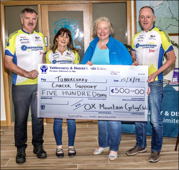 Stephen Henry, Monmica McCarrick and Ivan McGuire of the Ox Mounytain Cyclng Club present a cheque for€500 euro to Mary Jones of Tubbercurry Cancer Care