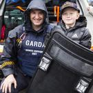 Ryan Irwin with a member of the Armed Support Unit at the Open Day at Ballymote Garda Station last Saturday. Pic: Donal Hackett