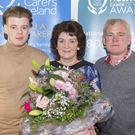 Winner of Sligo Carer of the Year award, Ann Marie Gilmartin with her son David and husband Gabriel