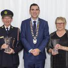 Pictured with Cathaoirleach of Sligo County Council, Cllr Tom MacSharry are Seamus Egan and Marion Davis who have retired from their roles with Sligo Civil Defence. Pic: Carl Brennan