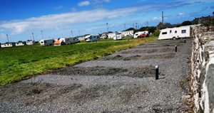 The camp site in Easkey and the stone garden wall of the neighbours to the right