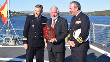 Eddie O'Gorman receives an award on behalf of Spanish Armada Ireland from the crew of the Spanish naval vessel OPV Centinela