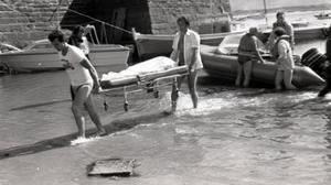 A casualty is brought ashore after the bombing